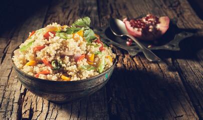 Large heaped bowl of organic quinoa salad