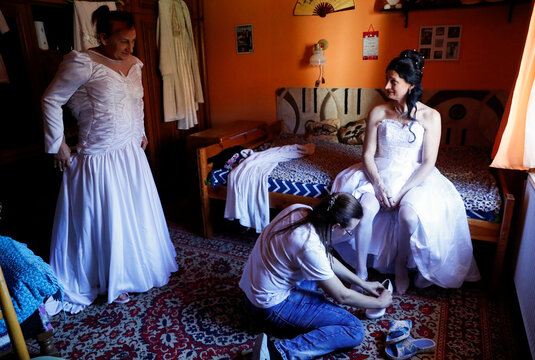 Hungarian transgender couple, Angyal and Csillag, prepare for their wedding at home in Polgardi