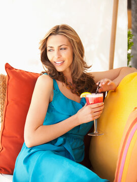 Caucasian woman relaxing and drinking cocktail