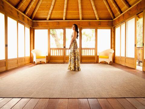 Asian woman standing in empty retreat