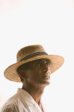Portrait of man wearing straw hat