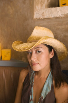 Portrait of woman wearing cowboy hat