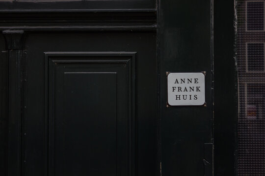 Amsterdam, Netherlands - June 20, 2014: A picture of the small sign marking the entrance of the Anne Frank House.