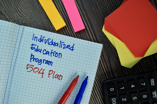 Individualized Education Program 504 Plan write on sticky note isolated on Wooden Table. Financial Concept