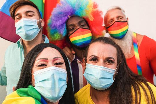Group of homosexual people enjoying gay pride taking  selfie during coronavirus outbreak - LGBT concept - Focus on right transgender face