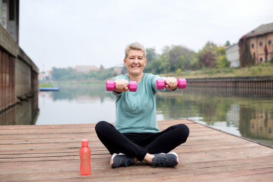 Healthy middle age   woman working out