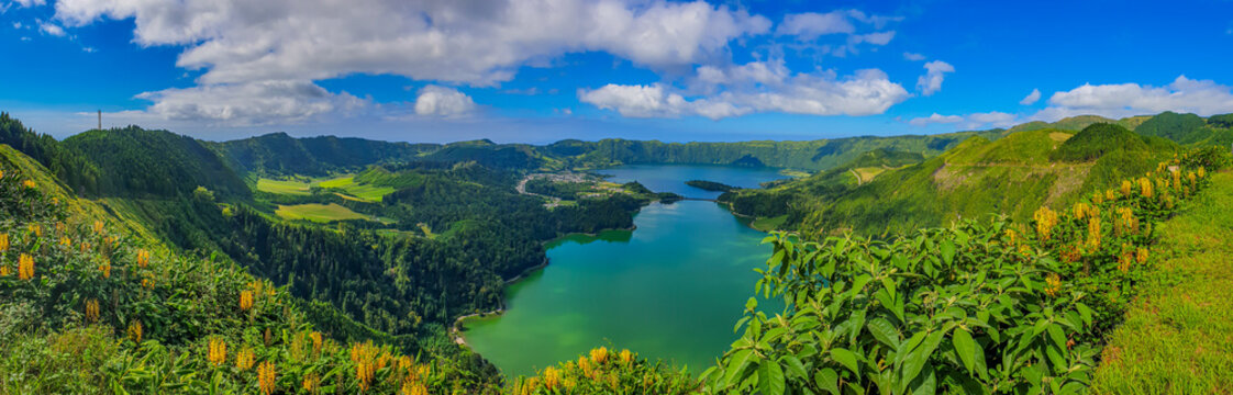 Panorama landscape with clouds and blue sky from the volcanic crater lake of Sete Citades in Sao Miguel Island of Azores Portugal