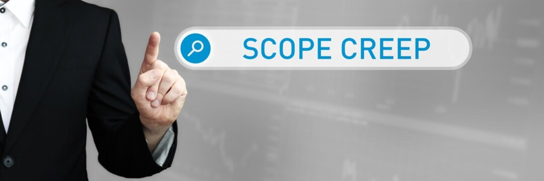 Scope Creep. Man pointing with his finger at search box in internet browser. Word/Text (blue) in the search.
