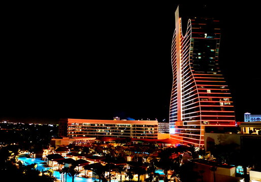 Hollywood, Florida, U.S.A - January 3, 2020 - Seminole Hard Rock Hotel and Casino illuminated with red and yellow neon lights at night