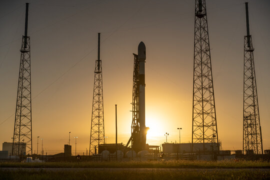 SpaceX Falcon 9 rocket on the launchpad at sunset