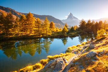 Wall Mural - Awesome view of Matterhorn spire. Location Grindjisee lake, Swiss alp, Switzerland, Europe.