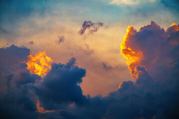 Wall Mural - Unusual ominous clouds illuminated by the beams of the sun.