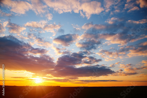 Wall mural Spectacular colorful sunset with cloudy sky.