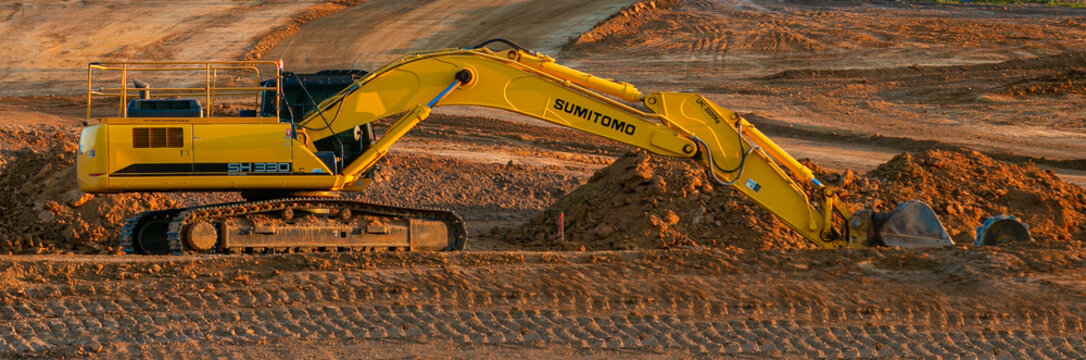 An excavator parked in a clearing area where the new suburb of Whitlam will be developed in Canberra, the Australian Capital Territory