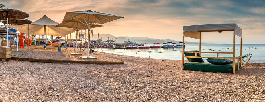 Morning panoramic view on relaxing facilities on sandy beach of the Red Sea, Middle East