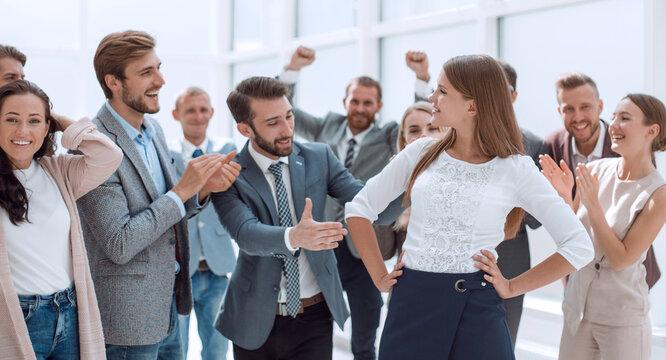 creative business team congratulating their young colleague