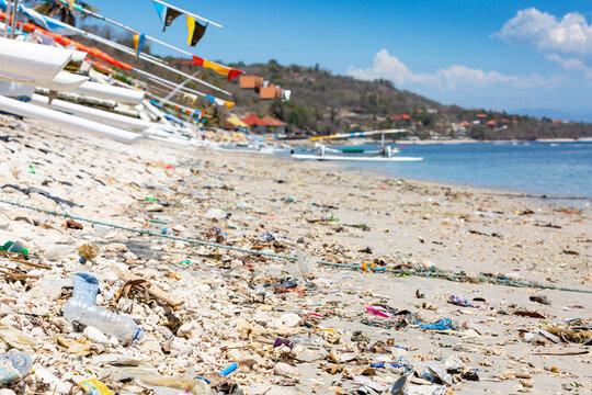 Plastic garbage washed ashore at a beach at Nusa Penida, Bali, Indonesia