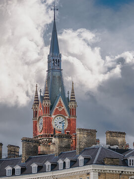 Close-up view of the ancient tower clock architecture of Kings Cross St. Pancras International Station in central London