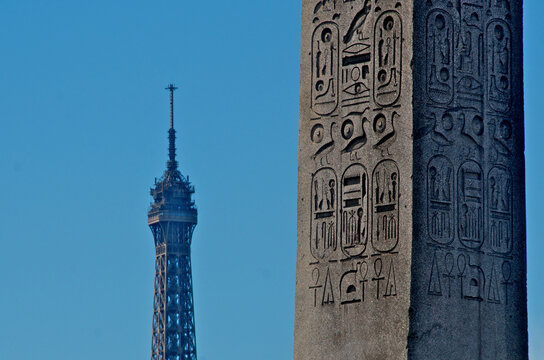 Egyptian obelisk from Luxor, juxtaposed with The Eiffel Tower (La tour Eiffel) Place de la Concorde, Paris