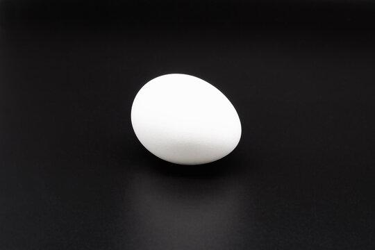 White egg on black.