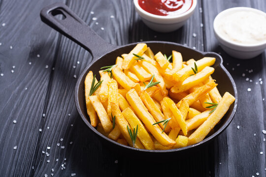 French fries with rosemary and ketchup