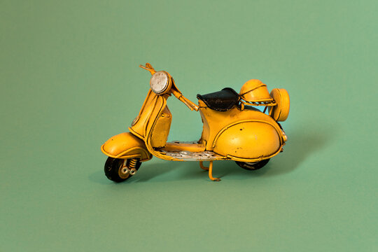 Old toy vespa motorbike on different backgrounds