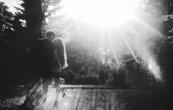 Beautiful young couple walking in the park. A romantic walk of man and woman, black and white photo. photo with noise. soft focus