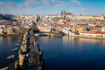 Aerial panoramic view from Old Town Bridge Tower, Karlov or Charles bridge and Vltava River in...