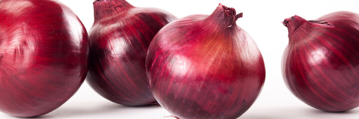 Food banner concept, organic vegetables and ingredients: close up of organic red onions