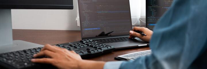 Software developer or programmer working data debugging improvement binary algorithm on desktop pc...