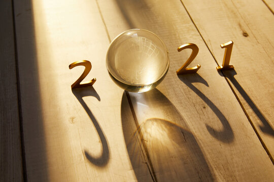 New Year 2021 Golden numbers 2021 with a crystal ball under the sunlight