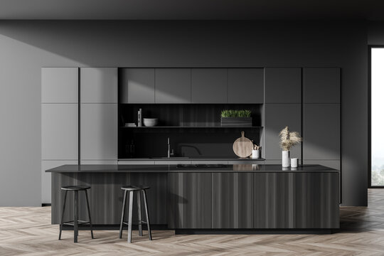 Dark gray kitchen interior with bar