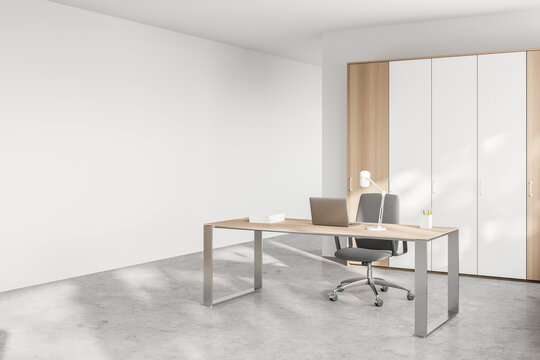White and wooden CEO office corner