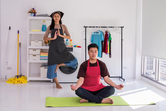 Asian couple wait laundry washing by yoga