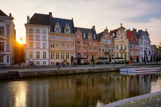 View of Korenlei quay and Leie river in the historic city center in Ghent (Gent), Belgium. Architecture and landmark of Ghent. Sunset cityscape of Ghent.