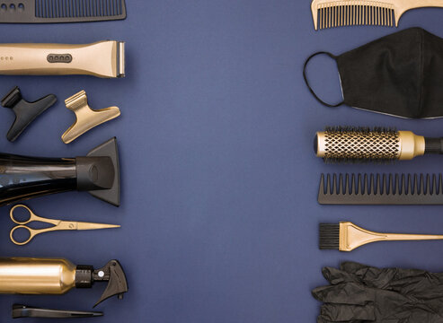 Hairdressing tools in gold and black on a blue background. Frame of Barber shop items, scissors, hairpins, gloves, mask, combs and hair dryer.