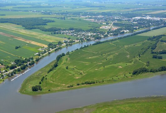 Summer scenic aerial view of the farmland on L`Ile aux Castors in the Saint Lawrence River, Berthierville in the background; Quebec Canada