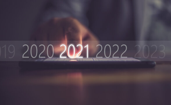 Business men press numbers 2021 at the mobile phone screen .Concept welcome merry christmas and happy new year 2021