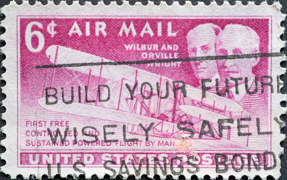 USA - Circa 1949 : a postage stamp printed in the US showing A portrait of the Wright Brothers with their flying device in Kitty Hawk, North Carolina. Air Mail