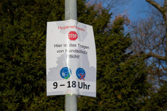 German letters, advice to wear mouth protection from 9am to 6pm in this area