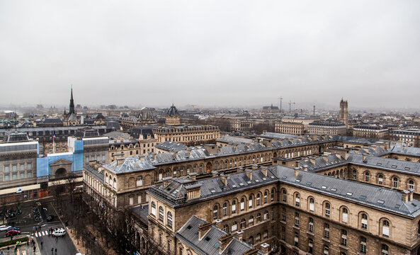 Paris city skyline in cloudy day from the top of Notre Dame Cathedral, Paris, France