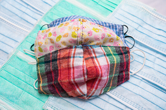 Colorful cloth face masks on surgical mask pattern background