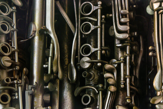 Closeup of musical woodwind instruments like flutes clarinets