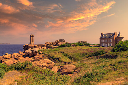 Sunset view of the Ploumanac'h Lighthouse and surroundings in Perros-Guirec on the Pink Granite Coast or Côte de Granit Rose. Brittany, France.