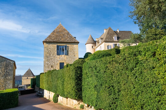 Green street in the medieval historical village leading to the castle Chateau de Marqueyssac. Dordogne, France.