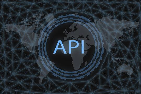 API - Application Programming Interface. Software development tool. API  inscription on a dark background and a world map.