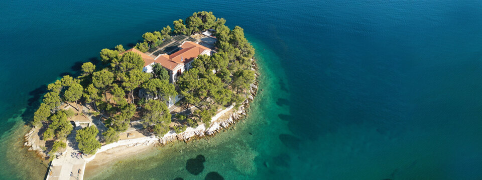 Aerial drone ultra wide panoramic photo of old town of Skiathos island, Sporades, Greece