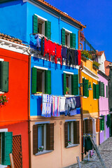 Colorful bright houses of traditional fishing village Burano near Venice. Popular touristic attraction. Italy