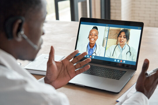 Multicultural doctors team conferencing in video call chat discussing health care learning online during web seminar. Group medical webinar training, healthcare elearning videoconference concept.