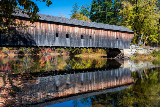 Hemlock covered bridge reflection over the Saco river